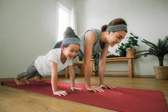 mom and daughter doing yoga at home