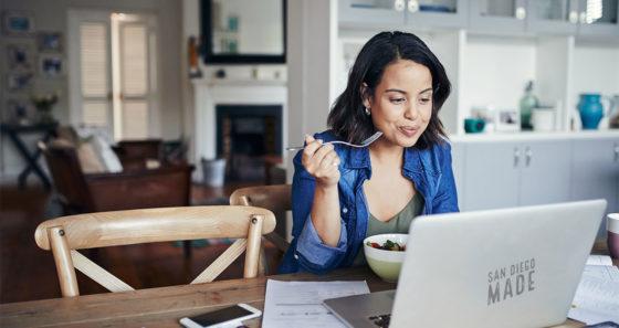 woman laptop kitchen