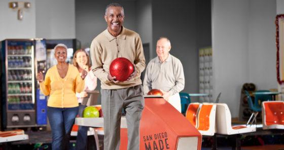 Mature friends bowling