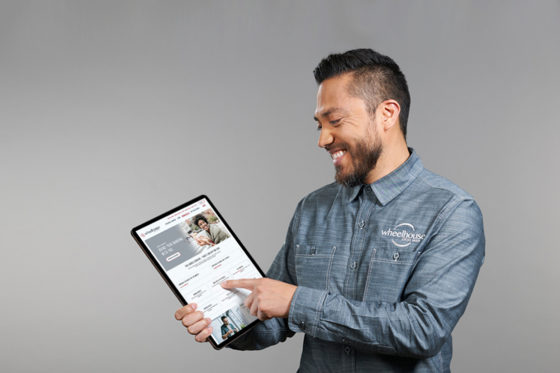 Staff member showing tablet