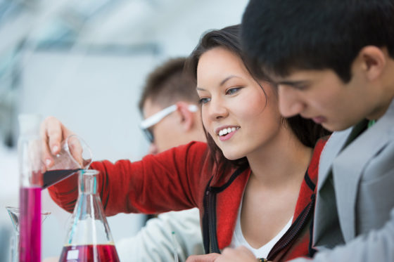 Girl experimenting lab solutions