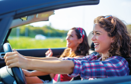 Girls driving in a convertible
