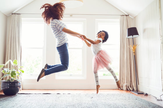 mother daughter jumping