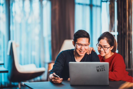 young asian couple working together on a laptop