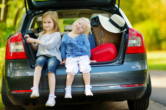 two girls auto trunk