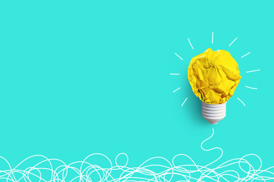 A lightbulb on a blue background