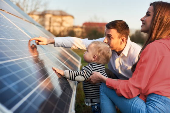 family looking at solar panels