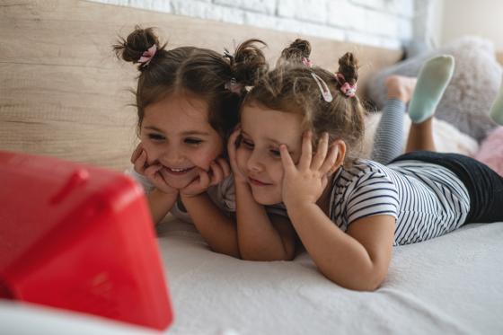 twin girls watching tv