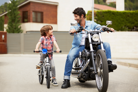 Dad and son on bikes
