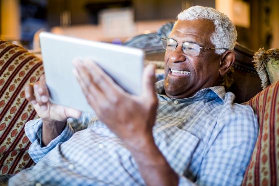 happy man on tablet
