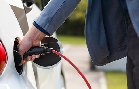 Man charging energy efficient car