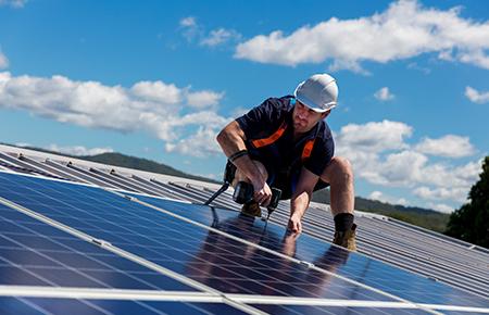 Solar Installer on Roof