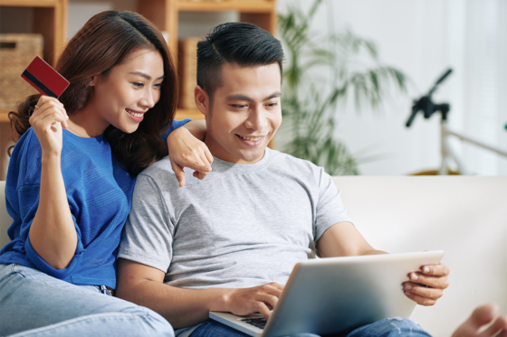 Happy couple making online purchase