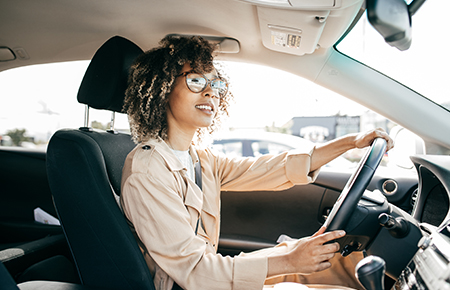Woman with glasses driving