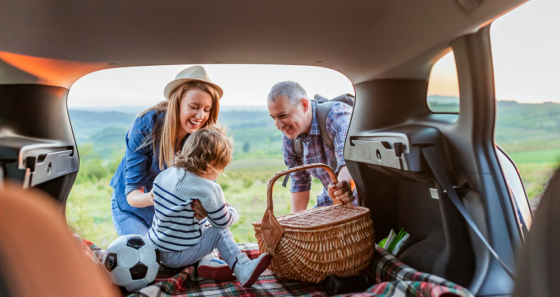family picnic in trunk of car