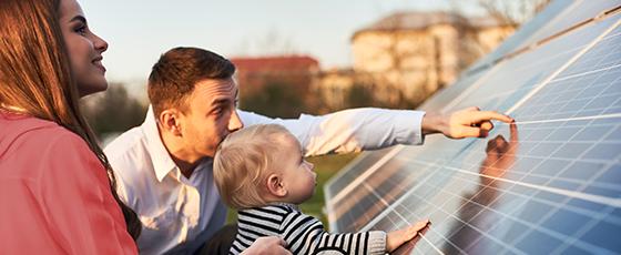 Family looking at solar panels