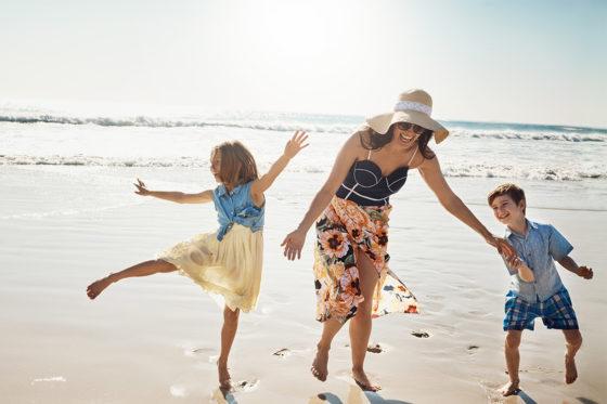woman kids beach fun
